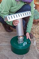 Assembling and lighting greenhouse heater