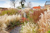 The Barn Garden with mixed perennials and grasses in naturalistic beds - The Bay Garden, Camolin, County Wexford, Ireland