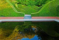 The Reflecting Pool and Hedge Garden with view to the Coppice and Yew hedges, Taxus baccata - Veddw House Garden, Monmouthshire, Wales