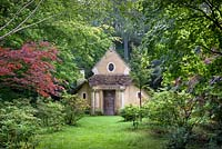 The Sanctuary in the Arboretum, Highgrove Garden, August 2012. The Sanctuary was built in 1999 to mark the Millennium and is a place of contemplation. Made of natural materials with cob walls, Bath stone footings and pillars of Cotswold stone on the roof.