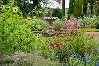 Fountain garden with beds full of salvias, zinnias, calendulas and other late season flowering plants