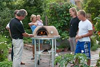 Man using an outdoor oven