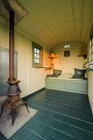 Interior of shepherds hut with pot belly stove - The Mill House, Little Sampford, Essex