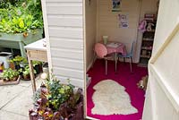 Garden shed used as childrens playhouse