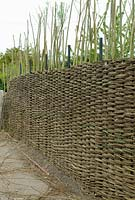Willow Fence Construction -  Further progress towards eventual height of fence