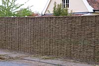 Willow Fence Construction -  Completed fence from the front with all loose ends having been trimmed back and crown woven into the top