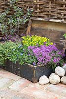 Large wooden box container with mixed herbs