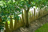 Carved decorative wooden fence - tilford cottage, surrey