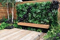 Vertical living wall above a cedar wood bench - Escape To The City - RHS Tatton Park Flower Show 2013