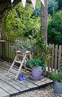 Decking with containers in summer