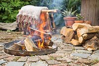 Firepit made from a dustbin lid with surrounding seating area