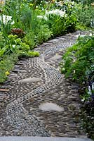 Apothecary pebble path - reflexology inlaid stones to walk barefoot in the Get Well Soon Garden