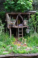 Garden of magical childhood, showing tree house