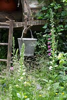The NSPCC Garden of Magical Childhood, treehouse -  galvanised bucket, Digitalis - Foxgloves, Hedera