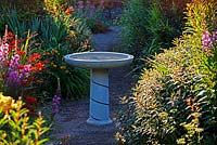 Bird Bath in the Front Garden, designed and decorated by Anne Wareham and made by Chilstone - Veddw House Garden, Devauden, Monmouthshire, Wales, UK