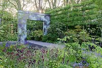 Copper archway. RHS Chelsea flower show 2014 - The Brewin Dolphin Garden, awarded silver gilt