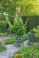 Potager / kitchen garden with wooden trellis topped with a cockerel. Les Confines, Provence, France
