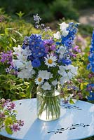 Arrangement with Delphinium, Leucanthemum, Centaurea cyanus, Stachys, Nepeta and Alchemilla