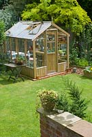 Greenhouse in garden setting