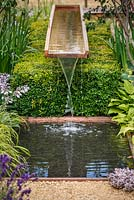 Water feature above Buxus Sempevirens, Vestra Wealth's Vista, RHS Hampton Court Flower Show 2014
