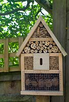 Insect house on wooden fence