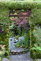 Moss arch in shady Japanese themed garden - Togenkyo - A Paradise on Earth - Designer Kazuyuki Ishihara - RHS Chelsea Flower Show 2014