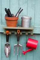 Potting shed tools with child's watering can