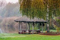 Wooden arbour next to the lake