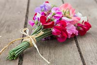 A bouquet of sweet peas on a wooden table
