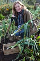 Lady digging winter leeks