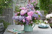 Paeonia and Syringa in outdoor arrangement