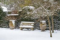 Stone seat and pots, Highgrove Garden in snow,  January 2013