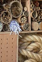 A mixture of natural and man-made materials combining in compartments to make an insect box and wildlife haven