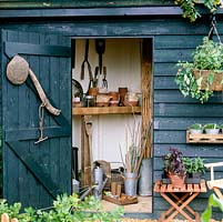 Tool shed in corner of kitchen garden.