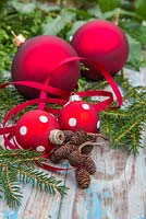 Red polkadot baubles with Ribbon, alder cones and yew foliage