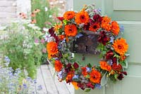Wreath of edible blossoms and herbs. Calendula - marigold, Tropaeolum - nasturtium, Salvia - sage, Petroselinu - parsley, Borag - borage  Tagetes tenuifolia and - Spice Tagetes