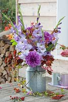Outdoor display with Dahlia, Gladiolus 'Cote d'Azur' and Parthenocissus