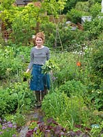 Alys Fowler, gardener, author and TV presenter, picks mint in her 18m x 6m back garden where she grows a mix of fruit, herbs, decorative flowers and vegetables in packed borders