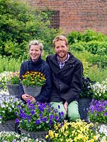 Jack Willgoss and Laura Crowe with some of their collection of hardy, perennial violas.