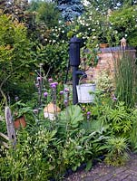 Victoria water pump in mixed vegetable and flower garden