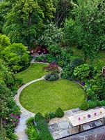 An aerial view of a lawn in modern town garden laid out on a circular theme.