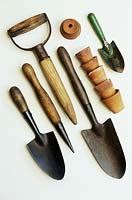 Hand trowels, dibbers, childs hand trowel and old flower pots