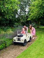 Scarlet 12,  Olivia 7 and Maja 13 taking the toy Landrover for a spin.