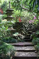Cobbled steps with Oriental pagoda in Oriental garden at Monte Palace Tropical Garden, Madeira