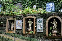 Tiled panels, niches filled with classical statuary, carved into the walls at Monte Palace Tropical Garden, Madeira
