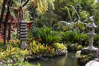 Oriental garden at Monte Palace Tropical Garden, Madeira, with series of ponds, Japanese lanterns and pagodas, and planted with clivia miniata and cycads