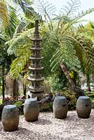 Seats in Oriental garden at Monte Palace Tropical Garden, Madeira, with Japanese pagoda and tree ferns