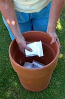 Fill bottom of terracotta container with pieces of polystyrene
