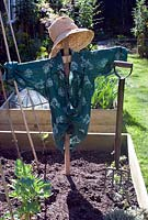 Scarecrow in vegetable bed, early spring