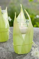 Glass jar with corn leaves used as a lantern